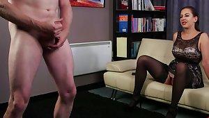 Clothed MILF Tindra Frost watches a loser jerk his own stiff meat